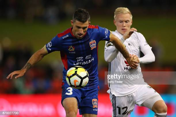 Jason Hoffman of the Jets contests the ball with Adam Parkhouse of the Phoenix during the round five ALeague match between the Newcastle Jets and the...