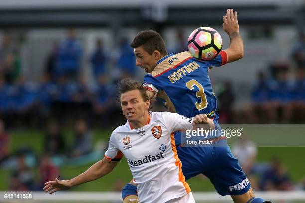 Jason Hoffman of the Jets contests the ball with Brett Holman of the Roar during the round 22 ALeague match between the Newcastle Jets and the...