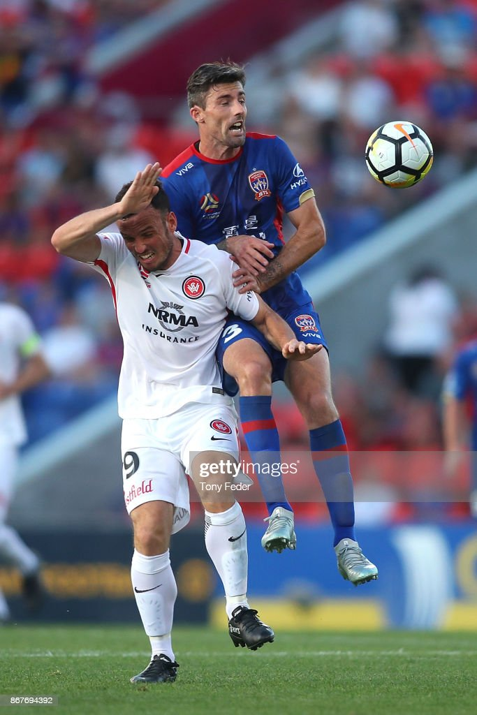 Jason Hoffman of the Jets contests the ball with Mark Bridge of the Wanderers during the round four A-League match between the Newcastle Jets and the Western Sydney Wanderers at McDonald Jones Stadium on October 29, 2017 in Newcastle, Australia.