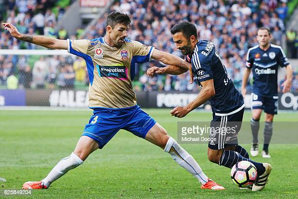 Jason Hoffman of the Jets defends the ball against Ben Khalfallah of the Victory during the round eight ALeague match between Melbourne Victory and...