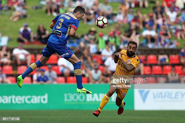 Jason Hoffman of the Jets heads the ball ahead of Diego Castro of the Glory during the round 15 ALeague match between the Newcastle Jets and the...