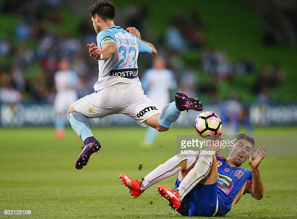 Jason Hoffman of the Jets tackles Bruno Fornaroli of the City during the round six ALeague match between Melbourne City FC and Newcastle Jets at AAMI...