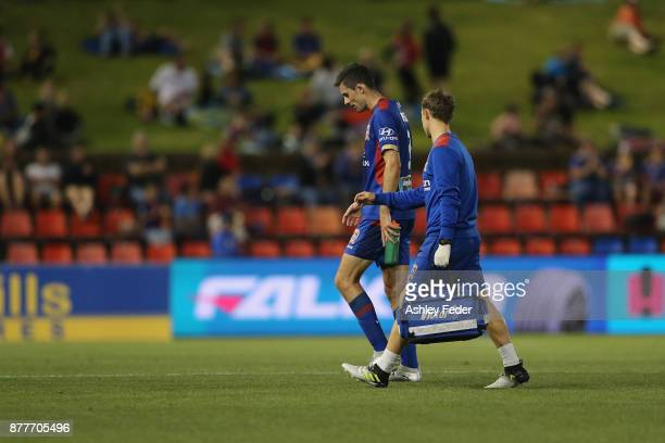Jason Hoffman of the Jets walks off injured during the round eight ALeague match between the Newcastle Jets and the Melbourne Victory at McDonald...