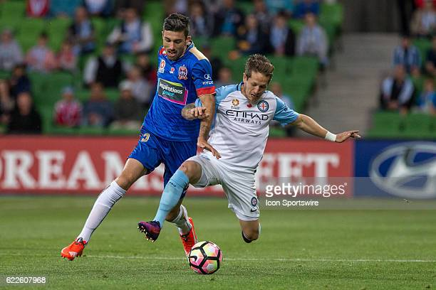 Jason Hoffman of the Newcastle Jets and Fernando Brandan of Melbourne City contest the ball during the 6th round of the Hyundai ALeague between...
