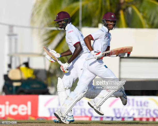 Jason Holder and Roston Chase of West Indies 100 runs partnership during the 1st day of the 2nd Test match between West Indies and Pakistan at...