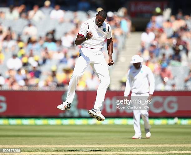 Jason Holder of the West Indies celebrates after taking the wicket of Joe Burns of Australia during day three of the Second Test match between...