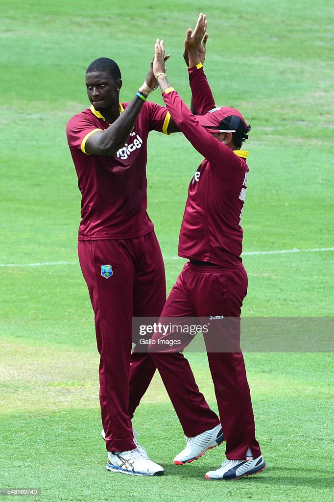Jason Holder of the West Indies celebrates the wicket of Usman Khawaja of Australia with Sunil Narine of the West Indies during the Tri-Nation Series One-day International (ODI) Final between West Indies and Australia at the Kensington Oval on June 26, 2016 in in Bridgetown, Barbados.