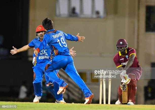 Jason Holder of West Indies bowled by Rashid Khan of Afghanistan during the 1st ODI match between West Indies and Afghanistan at Darren Sammy...
