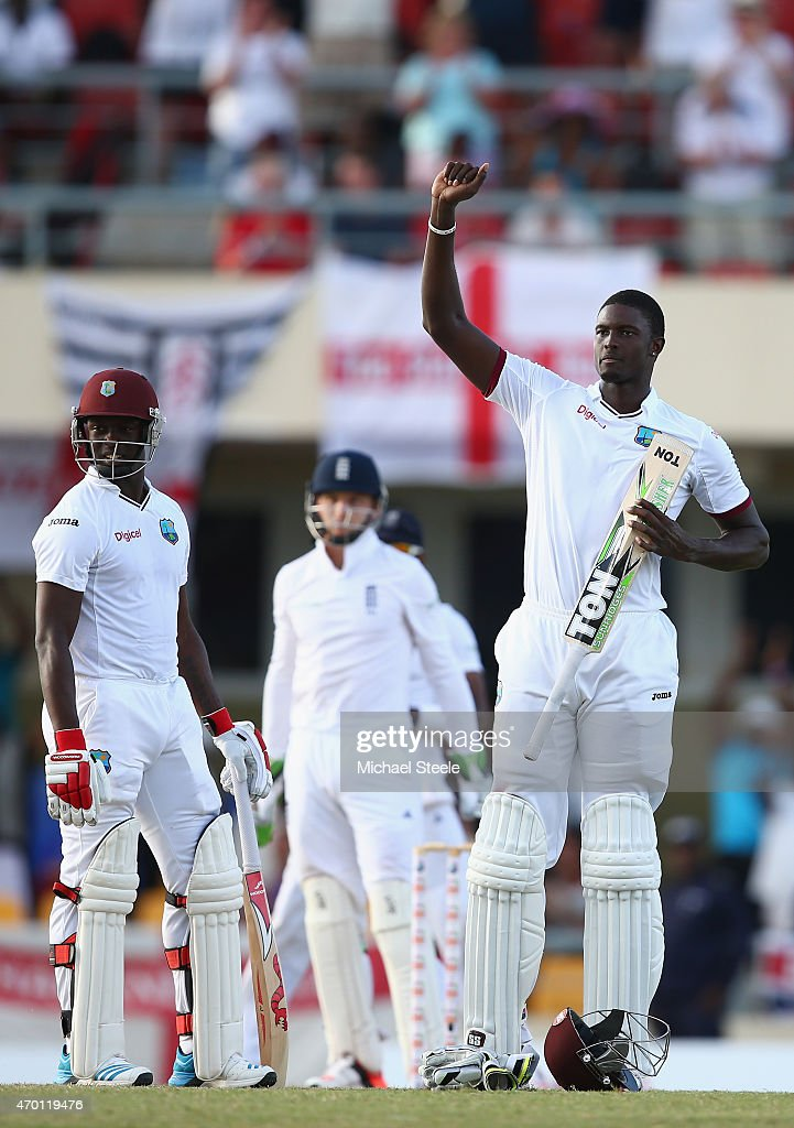 <a gi-track='captionPersonalityLinkClicked' href=/galleries/search?phrase=Jason+Holder&family=editorial&specificpeople=6681136 ng-click='$event.stopPropagation()'>Jason Holder</a> (R) of West Indies celebrates reaching his century alongside <a gi-track='captionPersonalityLinkClicked' href=/galleries/search?phrase=Kemar+Roach&family=editorial&specificpeople=5408487 ng-click='$event.stopPropagation()'>Kemar Roach</a> (L) during day five of the 1st Test match between West Indies and England at the Sir Vivian Richards Stadium on April 17, 2015 in Antigua, Antigua and Barbuda.