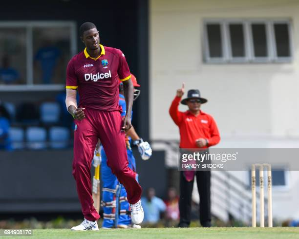 Jason Holder of West Indies celebrates the dismissal of Noor Ali Zadran of Afghanistan during the 2nd ODI match between West Indies and Afghanistan...
