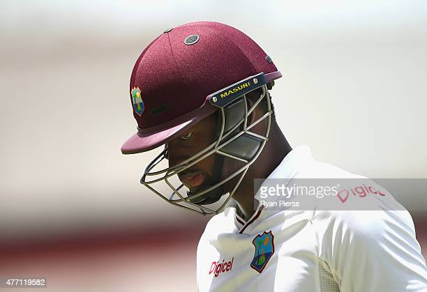 Jason Holder of West Indies looks dejected after being dismissed by Shane Watson of Australia during day four of the Second Test match between...