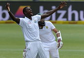 Jason Holder traps Hashim Amla lbw for 33 during day 3 of the 2nd Test match between South Africa and West Indies at St Georges Park on December 28...