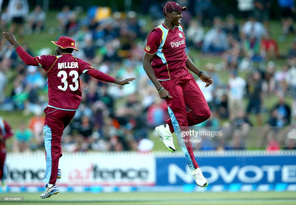 Jason Holderof the West Indies celebrates his runout of Kyle Mills of New Zealand during game five of the One Day International Series between New...