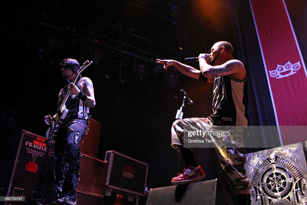 Jason Hook and Ivan Moody of Five Finger Death Punch perform supporting Avenged Sevenfold at the Ziggo Dome on November 19, 2013 in Amsterdam, Netherlands.