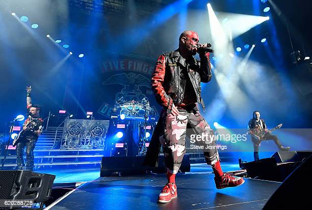 Jason Hook Ivan Moody and Zoltan Bathory of Five Finger Death Punch perform on Halloween night at SAP Center on October 31 2016 in San Jose California