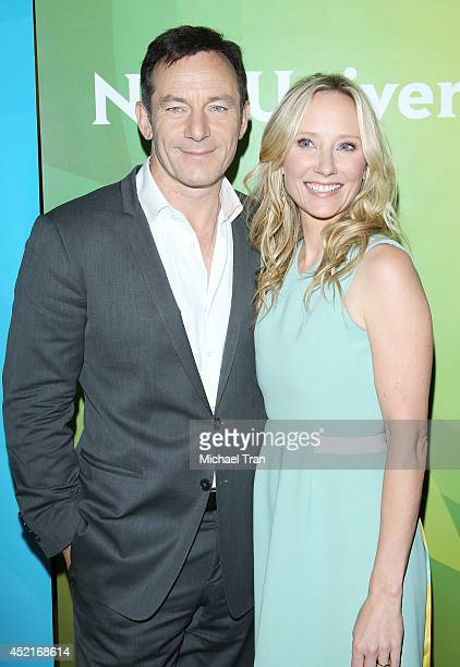 Jason Isaacs and Anne Heche arrive at the 2014 Television Critics Association Summer Press Tour NBCUniversal Day 2 held at The Beverly Hilton Hotel...