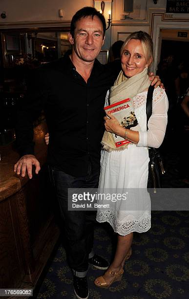 Jason Isaacs and Emma Hewitt pose in the foyer following the press night performance of 'Chimerica' at the Harold Pinter Theatre on August 15 2013 in...