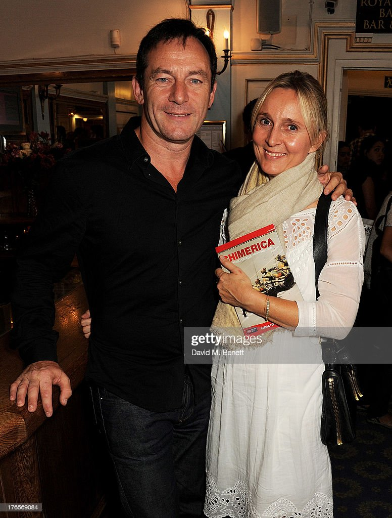 Jason Isaacs (L) and Emma Hewitt pose in the foyer following the press night performance of 'Chimerica' at the Harold Pinter Theatre on August 15, 2013 in London, England.