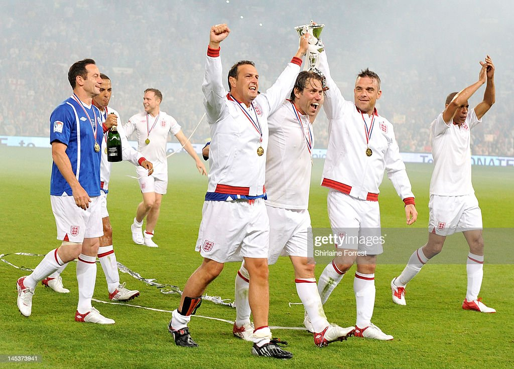 Jason Isaacs, Marvin Humes of JLS, Olly Murs, Paddy McGuinness, John Bishop, Robbie Williams and Des Walker celebrate winning as team England in charity football event Soccer Aid 2012 to raise funds for UNICEF on May 27, 2012 in Manchester, United Kingdom.