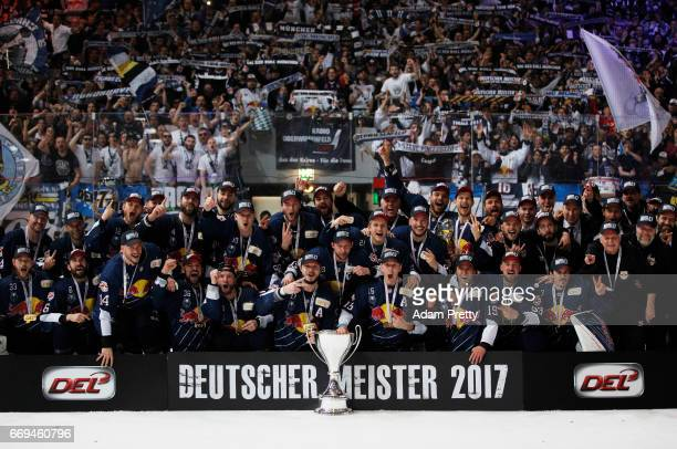 Jason Jaffray of Muenchen and his team mates celebrate winning the DEL PlayOffs Final Match 5 between EHC Muenchen and the Grizzlys Wolfsburg at...