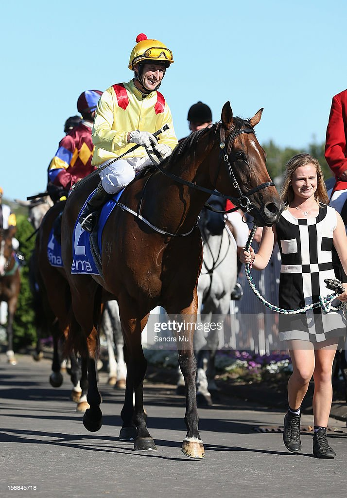 Jason Jago rides Fleur De Lune back to scale after winning the Sistema Railway Stakes at Ellerslie Racecourse on January 1, 2013 in Auckland, New Zealand.