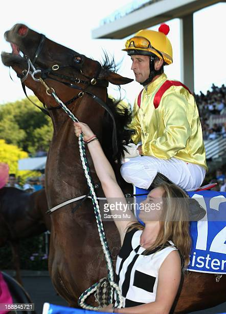 Jason Jago rides Fleur De Lune back to scale after winning the Sistema Railway Stakes at Ellerslie Racecourse on January 1 2013 in Auckland New...