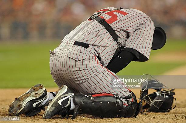 Jason Jaramillo of the Pittsburgh Pirates kneels in pain after being struck by a foul tip against the Detroit Tigers while wearing a Pittsburgh...