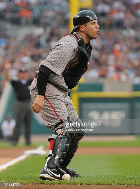 Jason Jaramillo of the Pittsburgh Pirates reacts after being struck by a foul tip against the Detroit Tigers while wearing a Pittsburgh Crawfords...