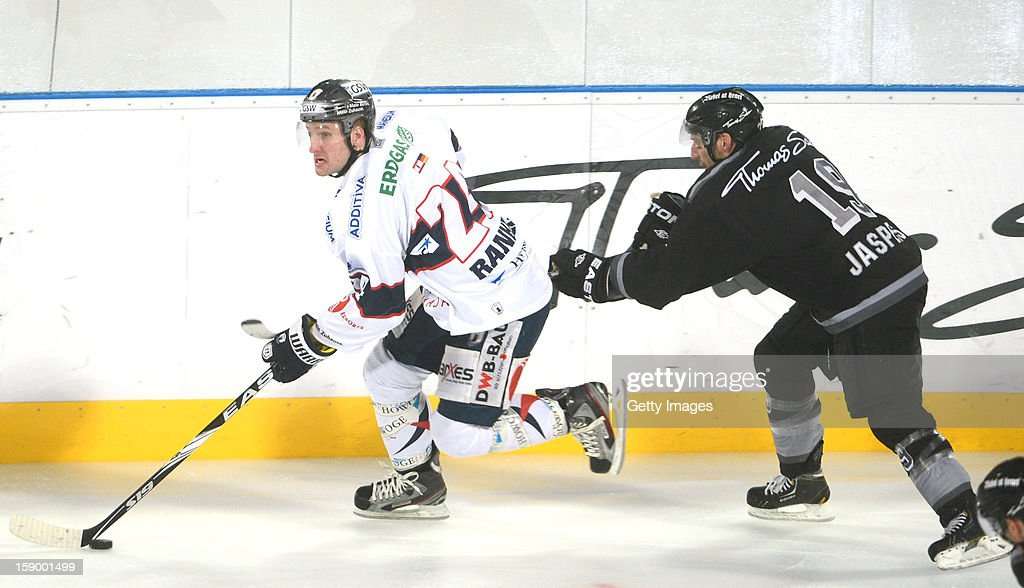 Jason Jaspers (R) of Nuremberg challenges Andre Rankel of Berlin during the DEL Winter Game 2013 at Stadion Nuernberg on January 5, 2013 in Nuremberg, Germany.