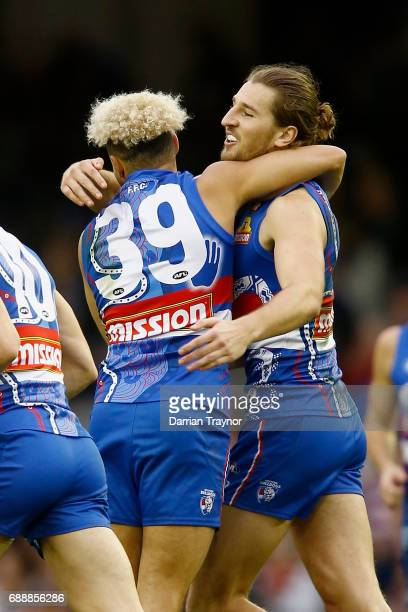 Jason Johannisen and Marcus Bontempelli of the Bulldogs celebrate a goal during the round 10 AFL match between the Western Bulldogs and the St Kilda...
