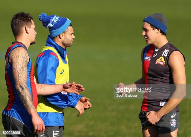 Jason Johannisen of the Bulldogs and Lukas Webb of the Bulldogs talk during a Western Bulldogs AFL training session at Whitten Oval on June 23 2017...