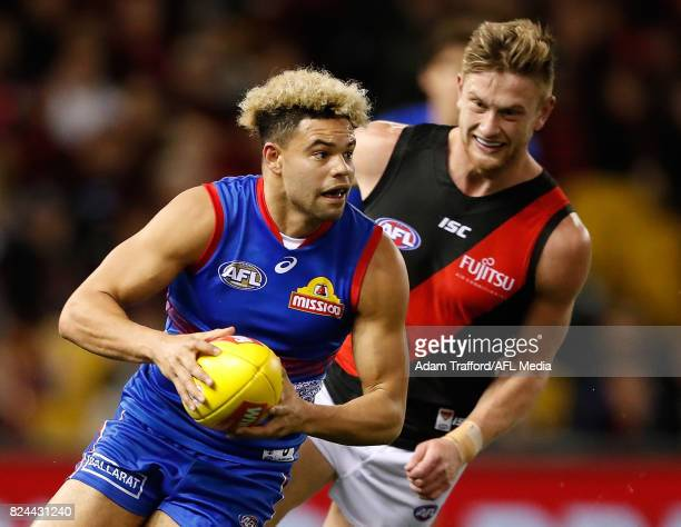 Jason Johannisen of the Bulldogs in action ahead of Jayden Laverde of the Bombers during the 2017 AFL round 19 match between the Western Bulldogs and...