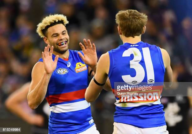 Jason Johannisen of the Bulldogs is congratulated by Bailey Dale after kicking a goal during the round 17 AFL match between the Carlton Blues and the...