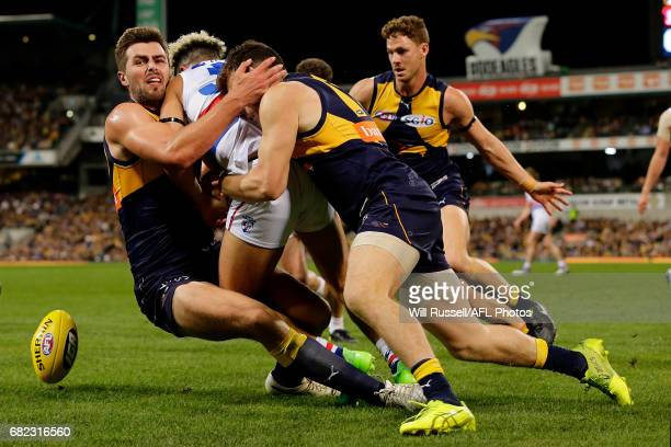 Jason Johannisen of the Bulldogs is tackled by Fraser McInnes and Luke Shuey of the Eagles during the round eight AFL match between the West Coast...