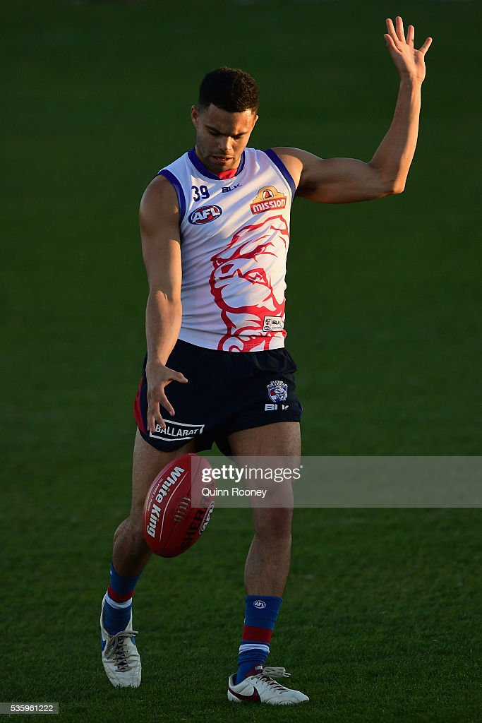 Jason Johannisen of the Bulldogs kicks during a Western Bulldogs AFL training session at Whitten Oval on May 31, 2016 in Melbourne, Australia.