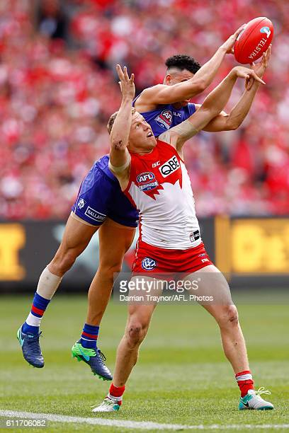 Jason Johannisen of the Bulldogs marks over Dan Hannebery of the Swans during the 2016 AFL Grand Final match between the Sydney Swans and the Western...