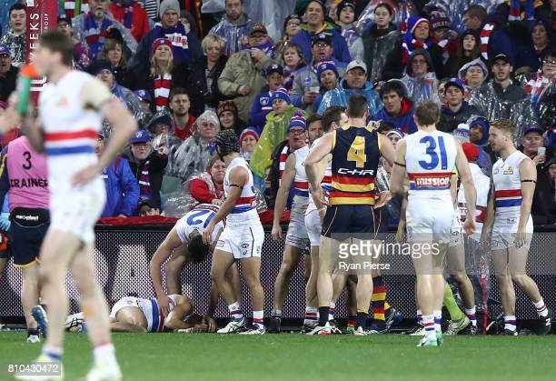 Jason Johannisen of the Bulldogs recovers after colliding with the goal post during the round 16 AFL match between the Adelaide Crows and the Western...