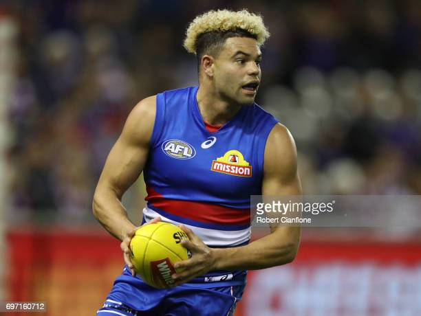 Jason Johannisen of the Bulldogs runs with the ball during the round 13 AFL match between the Western Bulldogs and the Melbourne Demons at Etihad...