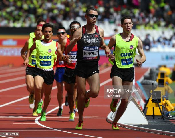 Jason Joseph Dunkerley of Canada and Jermie Nathaniel Venne compete in Men's 1500m T11 Round 1 Heat 1 during IPC World Para Athletics Championships...