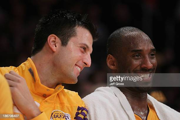 Jason Kapono and Kobe Bryant of the Los Angeles Lakers share a laugh from the bench against the New York Knicks at Staples Center on December 29 2011...