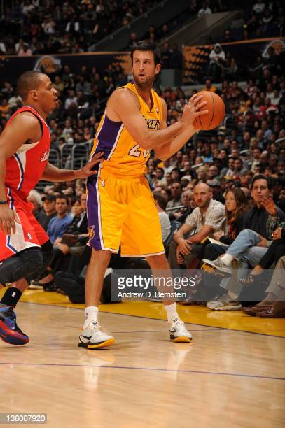 Jason Kapono of the Los Angeles Lakers holds the ball against Randy Foye of the Los Angeles Clippers at Staples Center on December 19 2011 in Los...