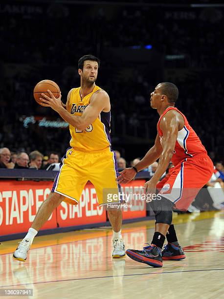 Jason Kapono of the Los Angeles Lakers looks to make a pass as he is guarded by Randy Foye of the Los Angeles Clippers at Staples Center on December...