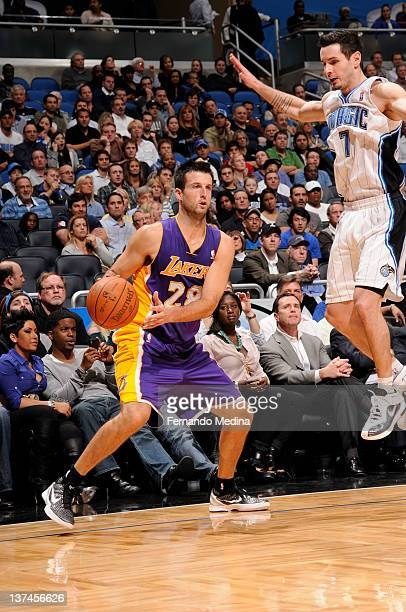 Jason Kapono of the Los Angeles Lakers protects the ball from JJ Redick of the Orlando Magic during the game between the Los Angeles Lakers and the...