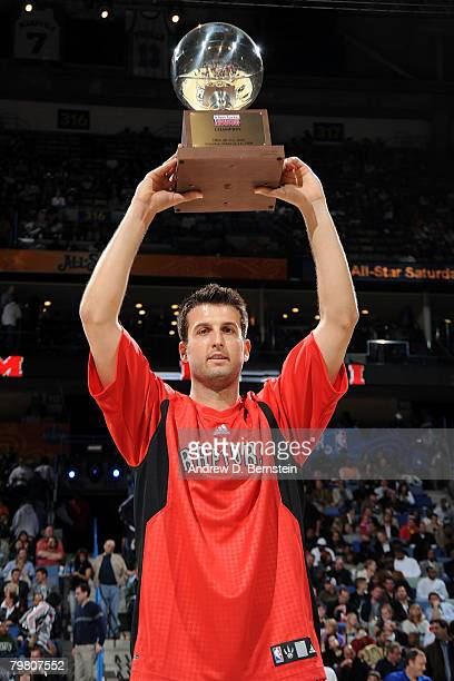 Jason Kapono of the Miami Heat holds up the trophy after winning the Foot Locker ThreePoint Shootout part of 2008 NBA AllStar Weekend at the New...