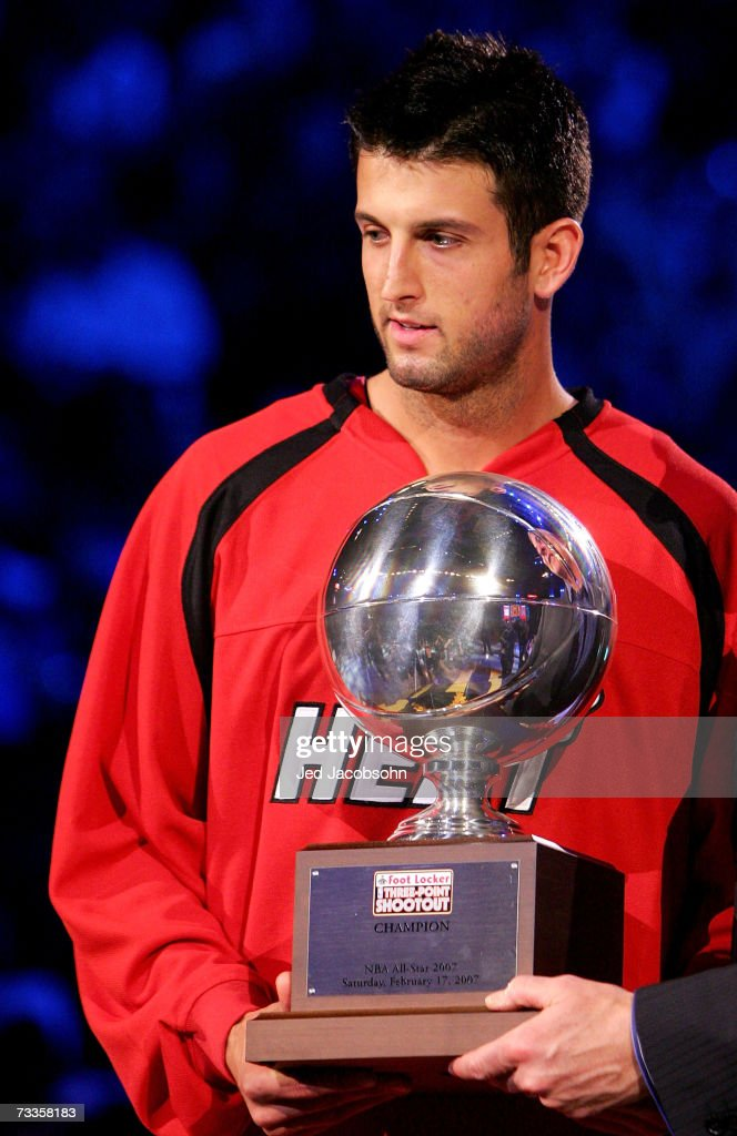 Jason Kapono of the Miami Heat poses with the trophy after winning the Foot Locker ThreePoint Shootout during NBA AllStar Weekend on February 17 2007...