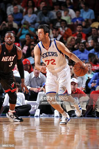 Jason Kapono of the Philadelphia 76ers moves the ball against Dwyane Wade of the Miami Heat during the game at Wachovia Center on April 12 2010 in...