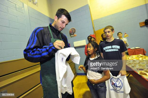Jason Kapono of the Philadelphia 76ers signs autographs during a Thanksgiving event on November 19 2009 at The Children's Home in Mount Holly New...