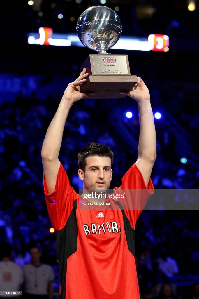 Jason Kapono of the Toronto Raptors holds up the championship trophy after winning the Foot Locker ThreePoint Shootout part of 2008 NBA AllStar...