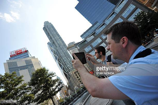 Jason Kendall instructor at William Patterson University uses a tablet computer to find Saturn in the sky before a group gathered at Columbus Circle...