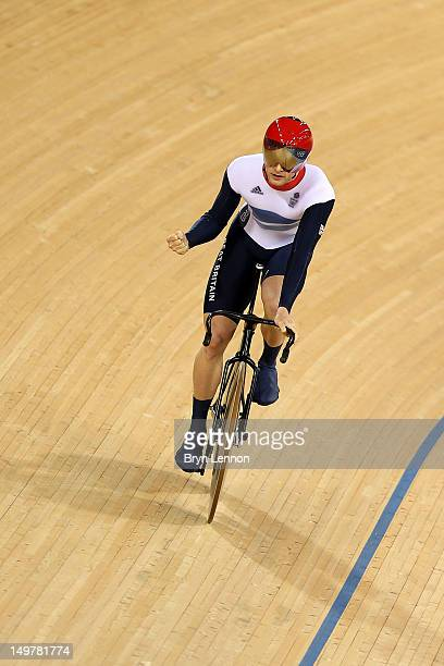 Jason Kenny of Great Britain celebrates winning and setting a new olympic record during Men's Sprint Track Cycling qualifying on Day 8 of the London...